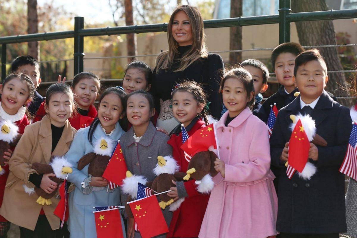US First Lady Melania Trump (centre) takes a group photo with Chinese children during a visit to the Beijing Zoo in Beijing, China, on Nov 10,  2017.