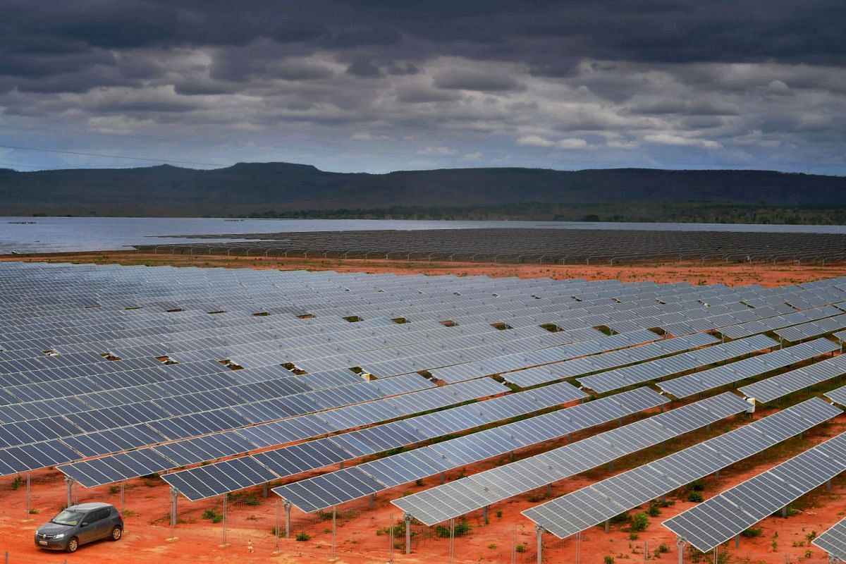 A view of solar panels in Pirapora, Minas Gerais state, Brazil, the largest photovoltaic plant in Latin America, on November 9, 2017. The 800-hectare solar farm is in the middle of a plain 350 km north of Belo Horizonte and holds over one million sol