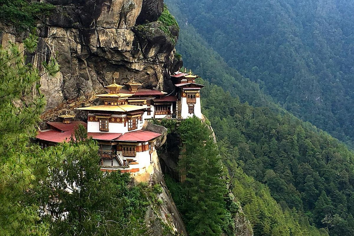 Tiger's Nest is a monastery in Bhutan that is 3,120m above sea level. A panoramic view of Paro Valley. The market in Phobjikha (above) and the Thimphu Memorial Stupa (left).