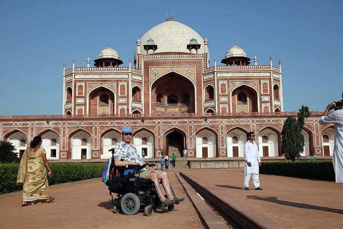 Mr Martin Heng, who works at Lonely Planet, at the Humayun's Tomb in New Delhi, India. Mr Richard Kuppusamy, president of the Disabled People's Association, getting help boarding a plane in Dublin.