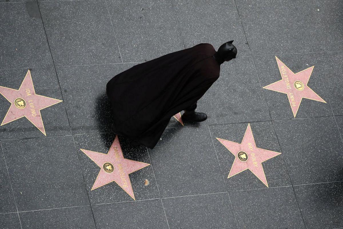 A man dressed as Batman walks on the Hollywood Walk of Fame in Hollywood, Los Angeles, California U.S. November 12, 2017.