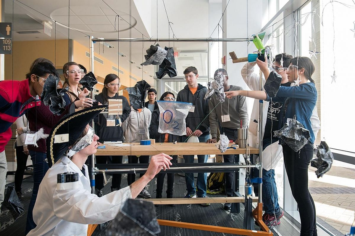 Applicants to Olin College of Engineering finish a design challenge to create a space vehicle. Such activities help the college understand prospective students better.