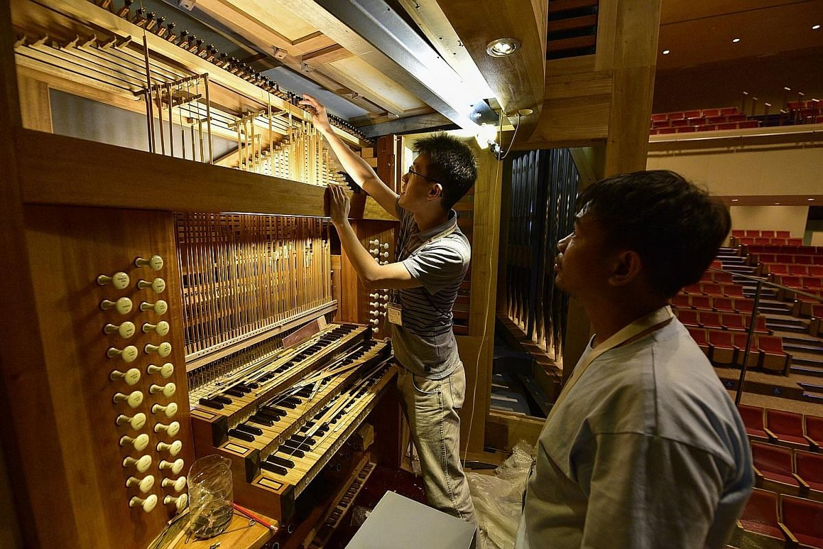 A specialist team carries the wooden base of the organ's facade into the Alleyn Theatre in Dulwich College Singapore. It took 15 craftsmen about a year to make the organ's parts in Diego Cera's workshop in Las Pinas, a city near Manila. The organ was