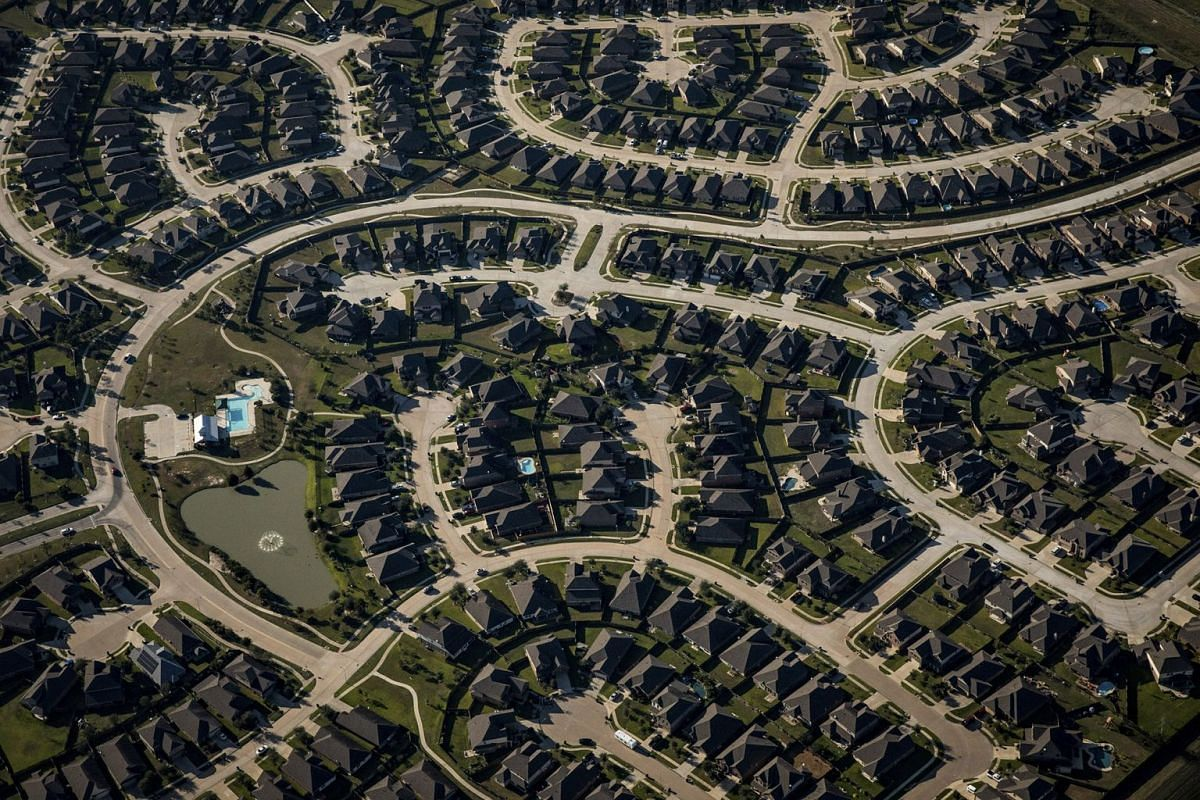 The Waterstone neighborhood in Katy, Texas, just inside the new Grand Parkway on the western edge of the Houston sprawl, Oct. 18, 2017. Houston has become a giant spread of asphalt smothering many of the floodplains that once shuttled water from the