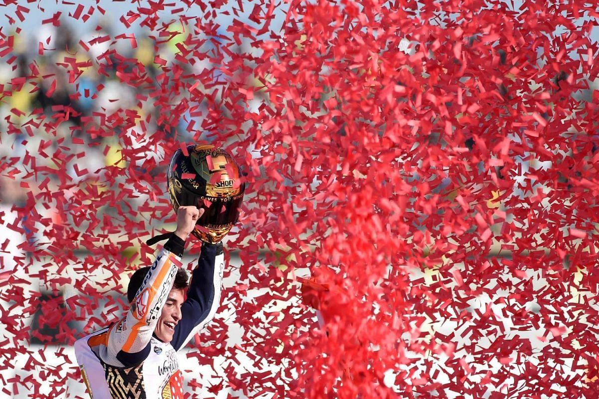 Repsol Honda Team's Spanish rider Marc Marquez celebrates after the MotoGP race of the Valencia Grand Prix at Ricardo Tormo racetrack in Cheste, near Valencia on November 12, 2017.