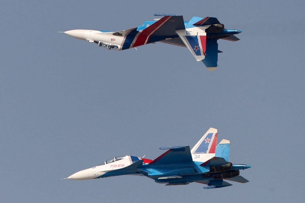 The Russian Knights aerobatic team perform during the Dubai Airshow on November 12, 2017, in the United Arab Emirates.