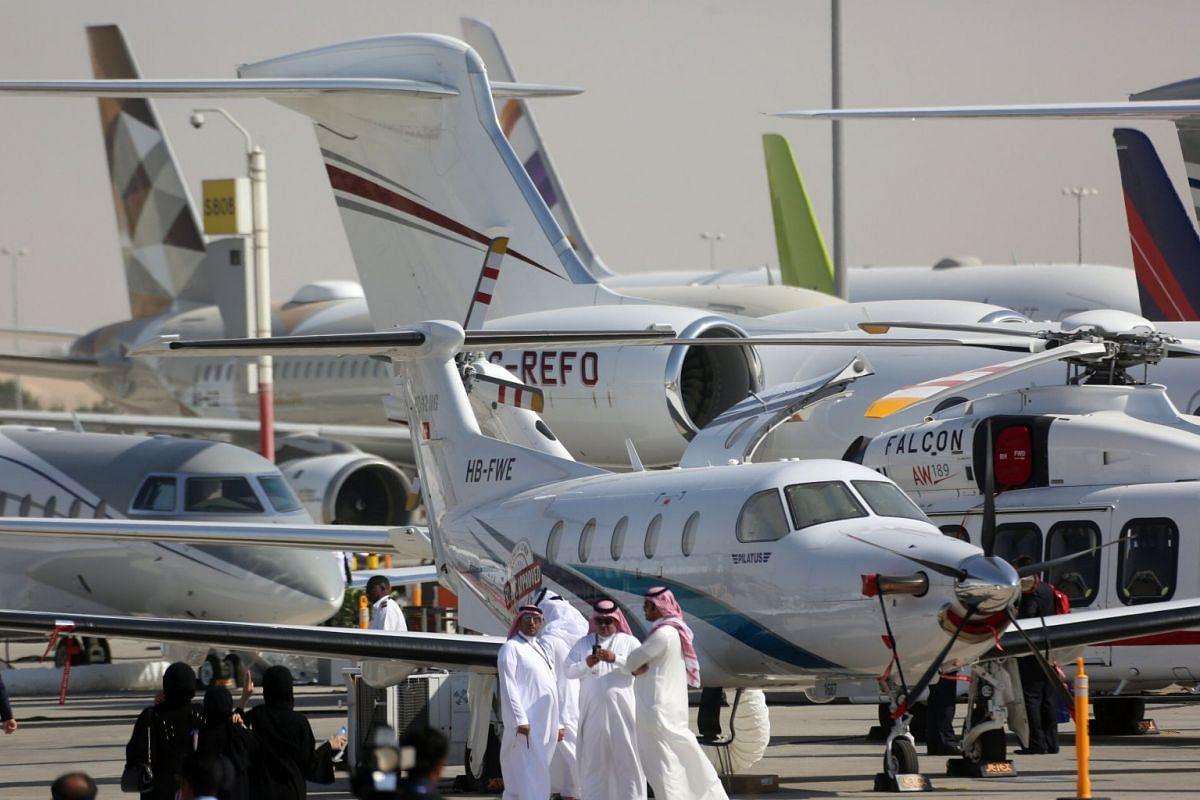 Visitors are seen during the Dubai Airshow in Dubai, UAE November 13, 2017.