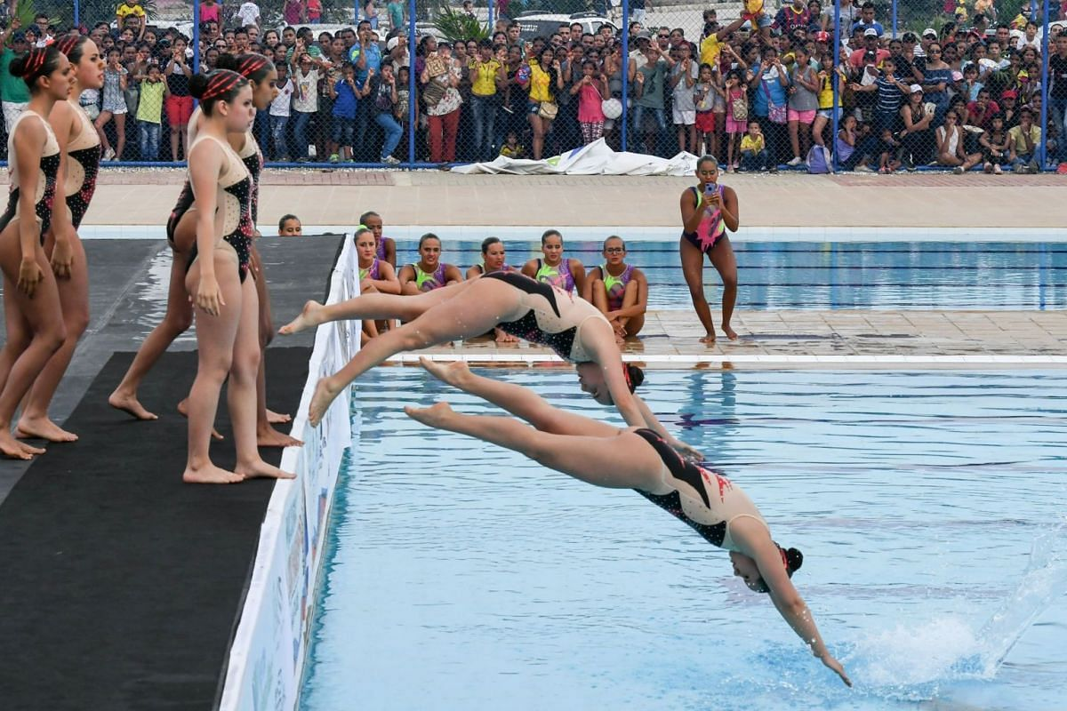 Perus's Women Team compete in the Teams Women Synchronized Swiming Free Series routine at the XVIII Bolivarian Games in Santa Marta, Colombia on November 12, 2017.