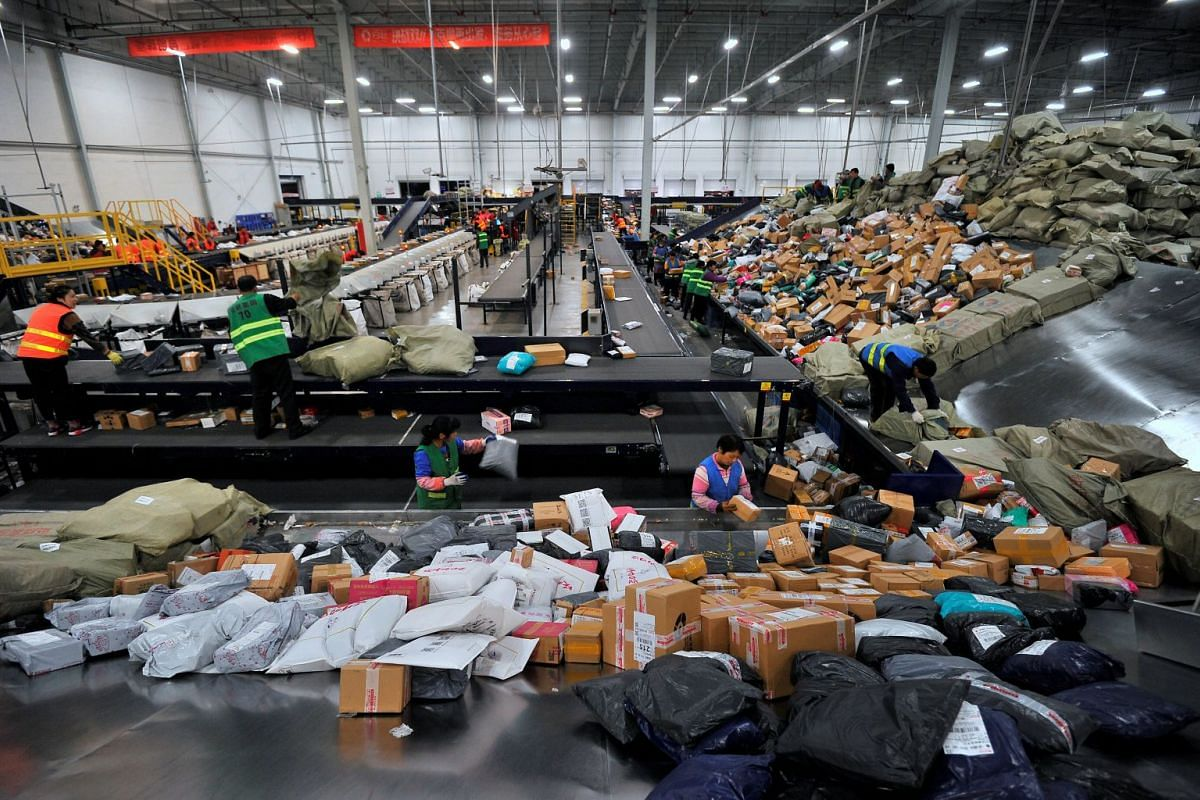 Employees sort boxes and parcels at a logistic centre of BEST Express delivery company, after the Singles' Day online shopping festival, in Jinan, Shandong province, China November 13, 2017.