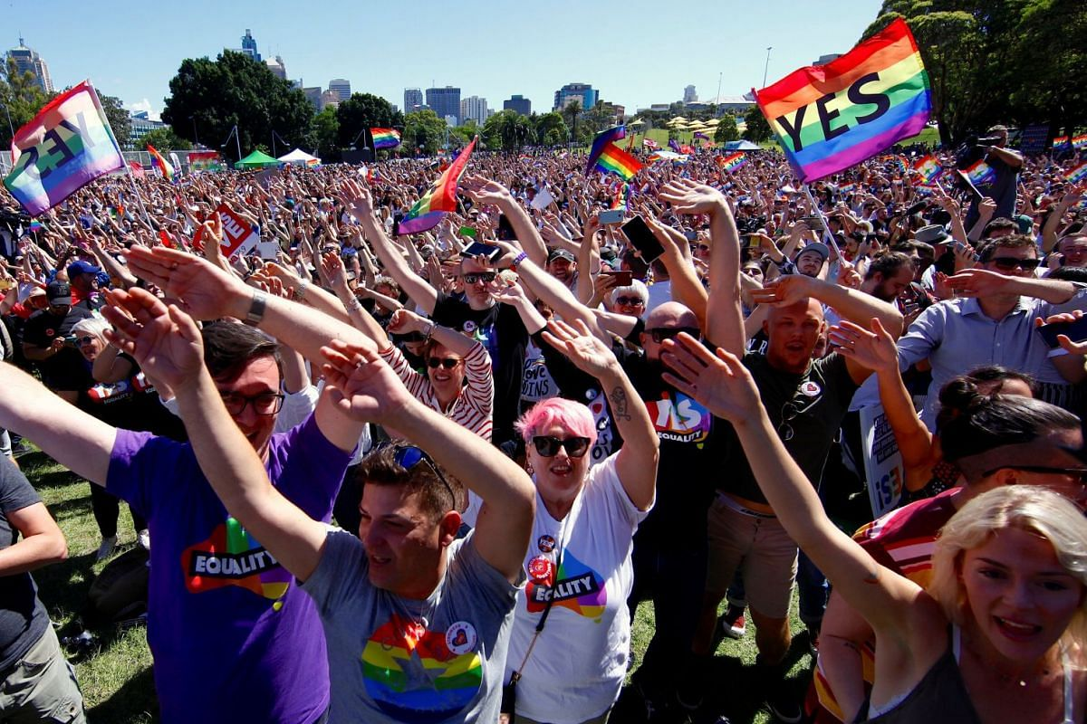 Supporters of the 'Yes' vote for marriage equality celebrate after it was announced the majority of Australians support same-sex marriage in a national survey, paving the way for legislation to make the country the 26th nation to formalise the unions
