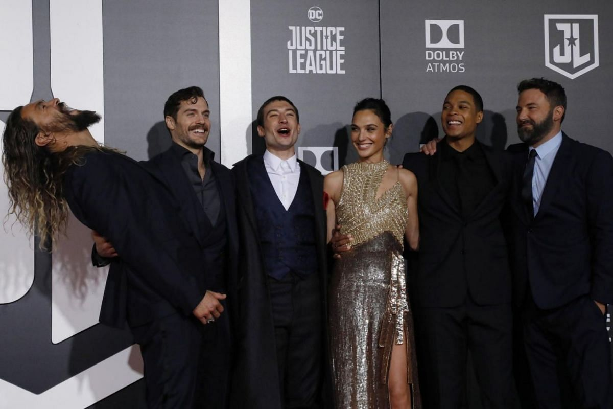 Cast members Jason Momoa, Henry Cavill, Ezra Miller, Gal Gadot, Ray Fisher and Ben Affleck pose on the red carpet at the world premiere of Justice League on Nov 13, 2017.