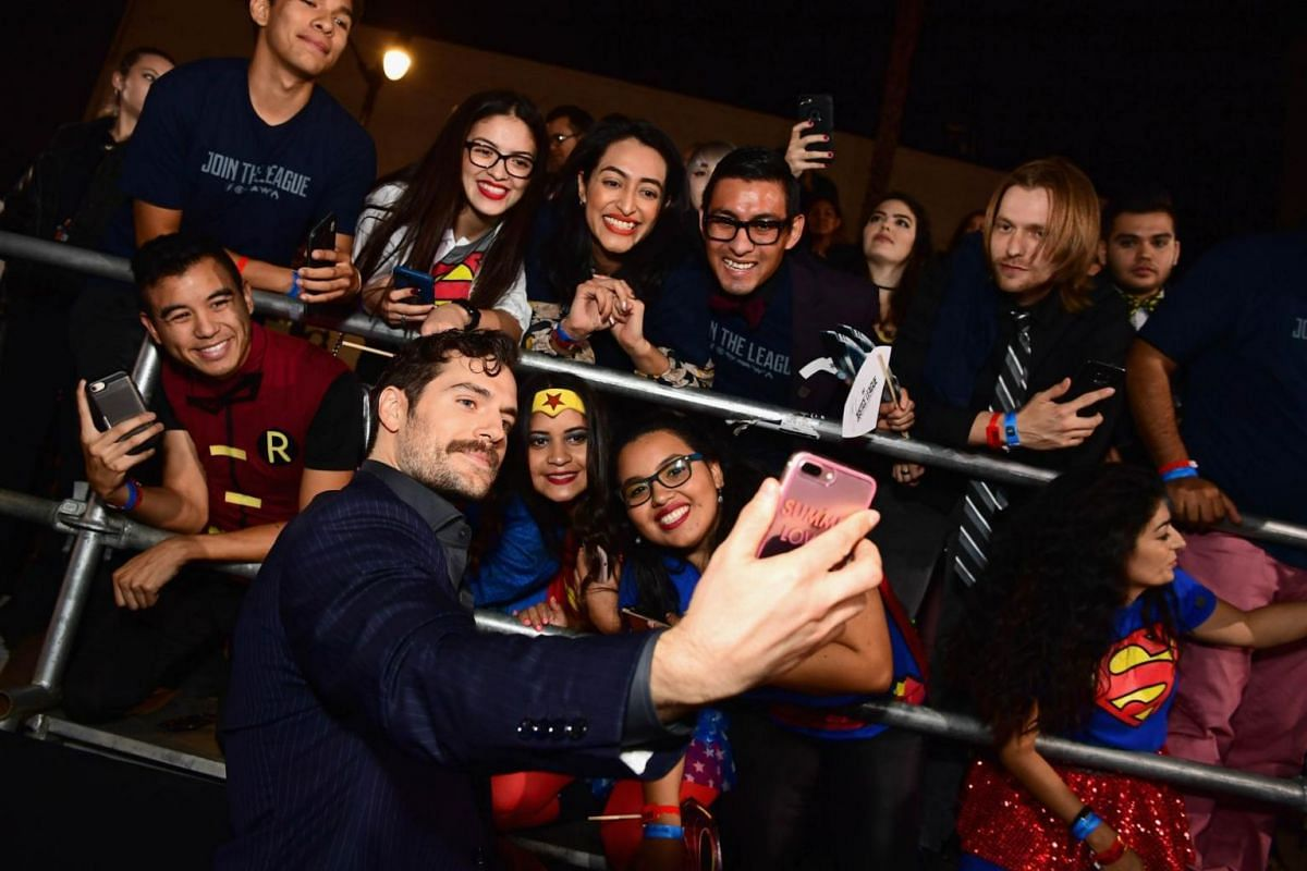 Actor Henry Cavill, who plays Superman, takes selfies with fans during the premiere of Justice League at Dolby Theatre on Nov 13, 2017.