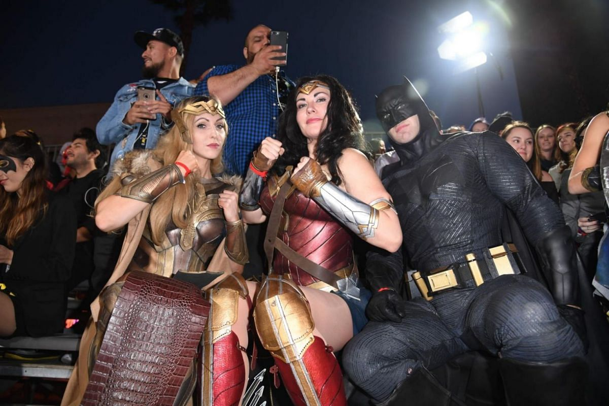 Fans in costume attend the world premiere of Justice League at the Dolby Theater in Hollywood, California on Nov 13, 2017.