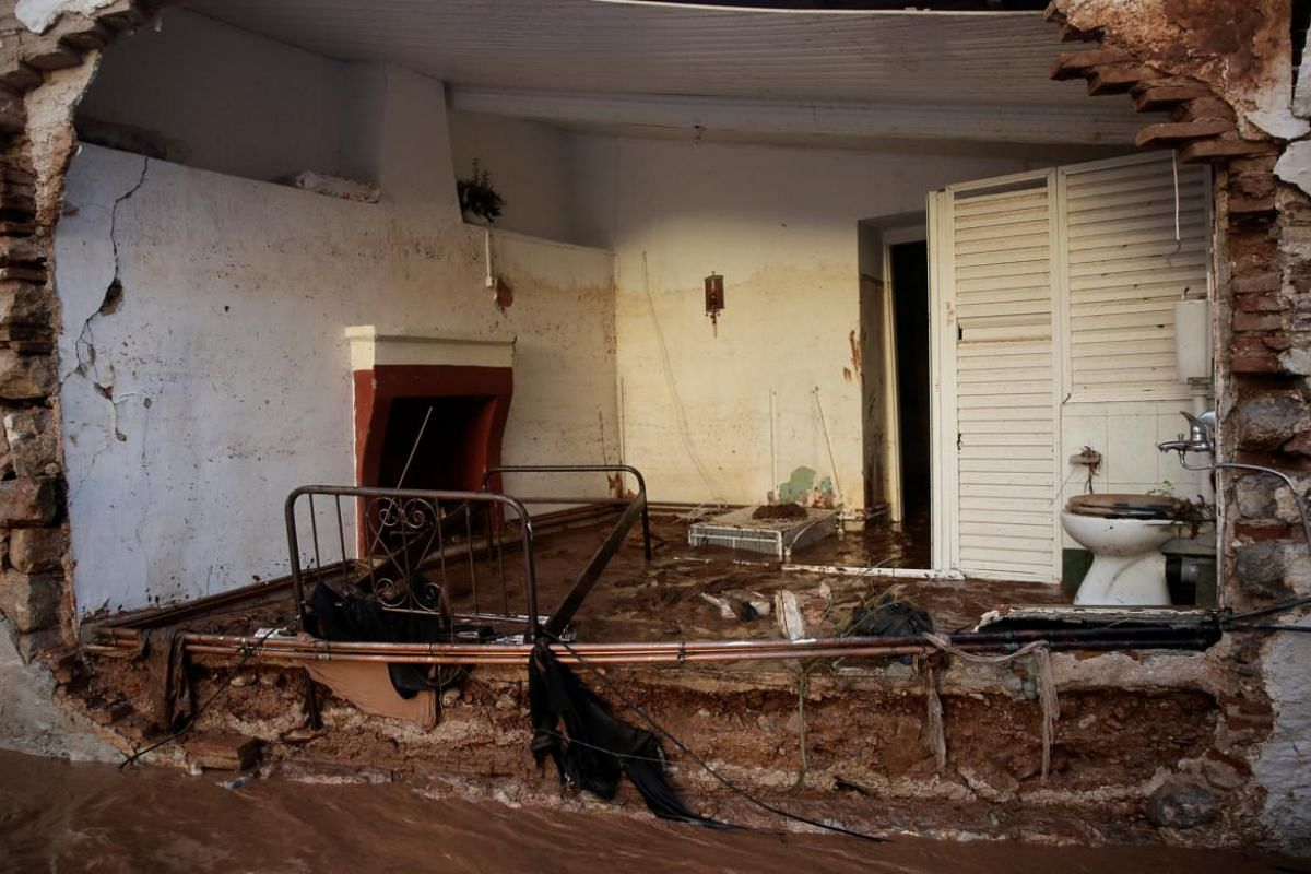 Part of a destroyed house is seen following heavy rainfall in the town of Mandra.