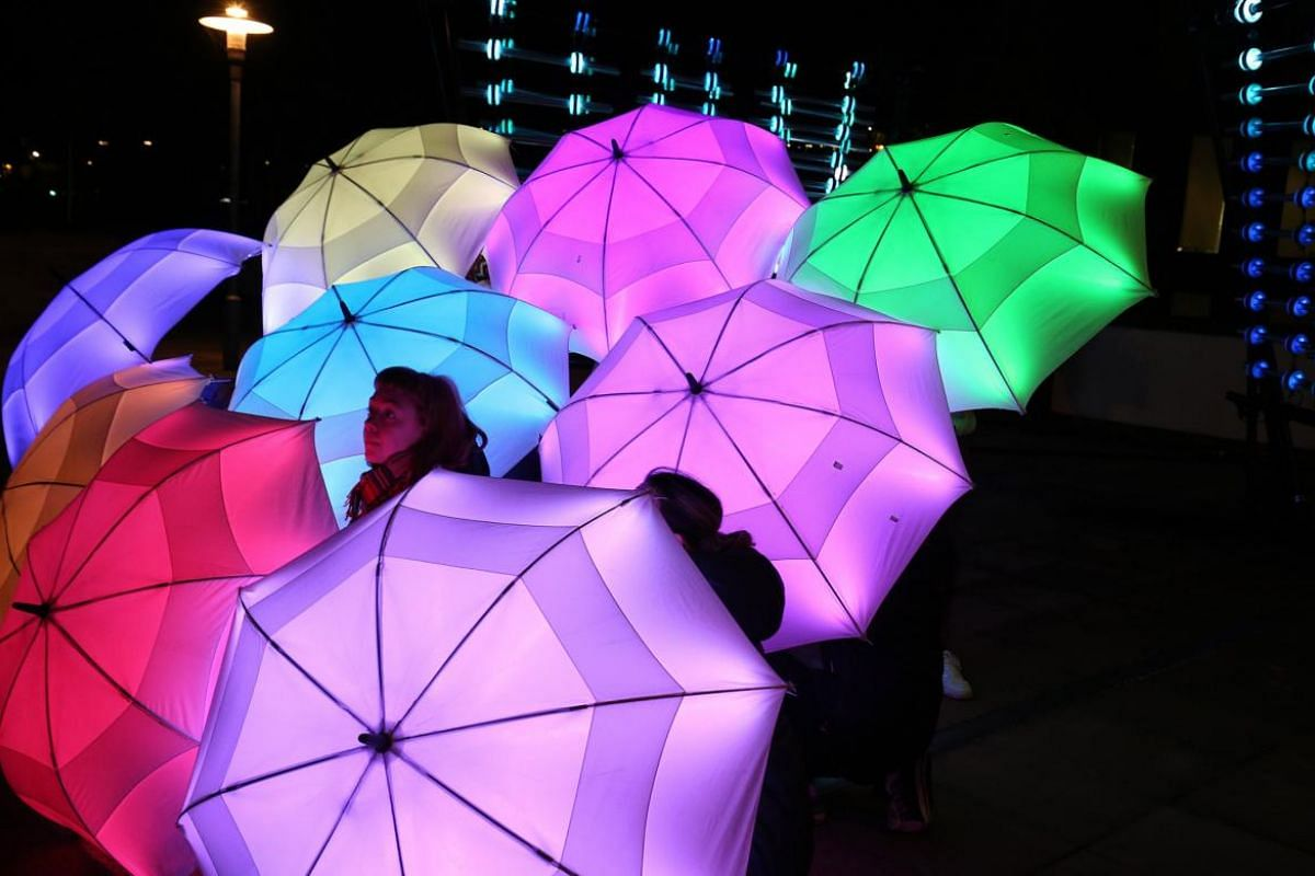 The performance 'The Umbrella Project' by British artistic collective Cirque Bijou.