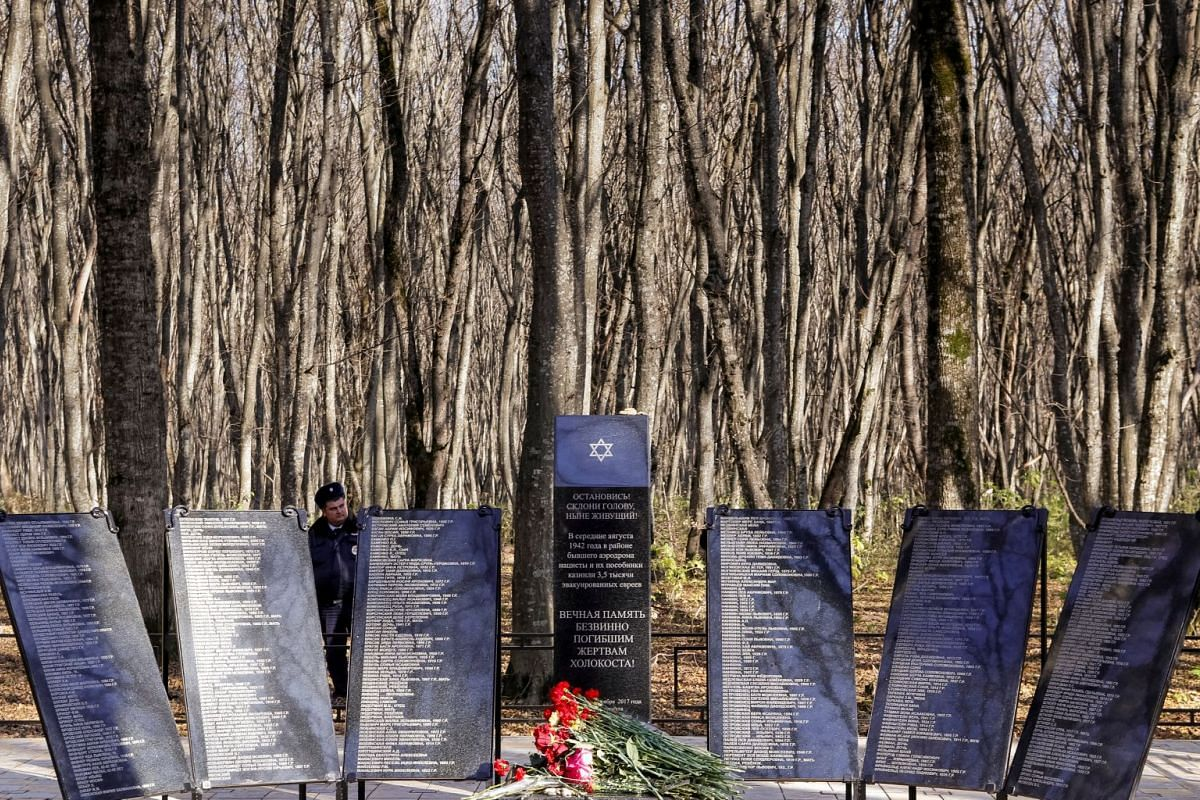 A police officer stands next to the monument commemorating the victims of the Nazi Holocaust killed in 1942, during its opening ceremony in Stavropol, Russia, November 15, 2017.