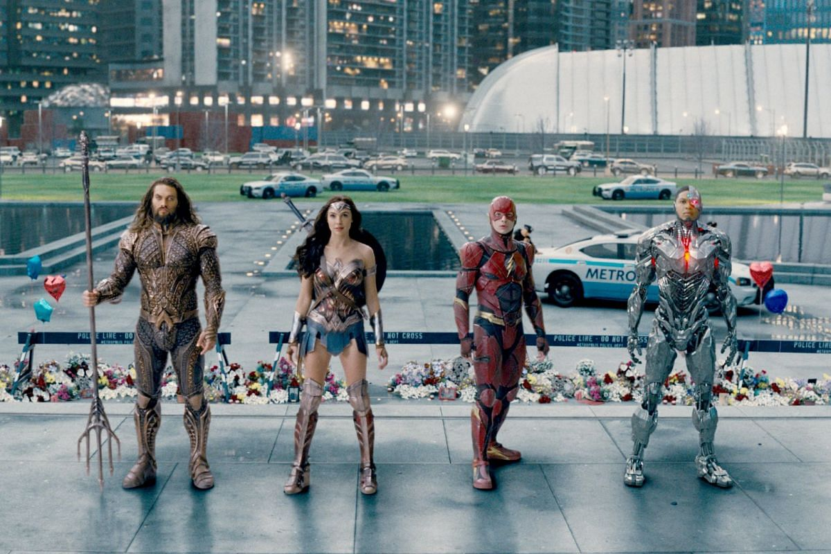 The members of the Justice League assemble, from left to right: Jason Momoa as Aquaman, Gal Gadot as Wonder Woman, Ezra Miller as the Flash and Ray Fisher as Cyborg.