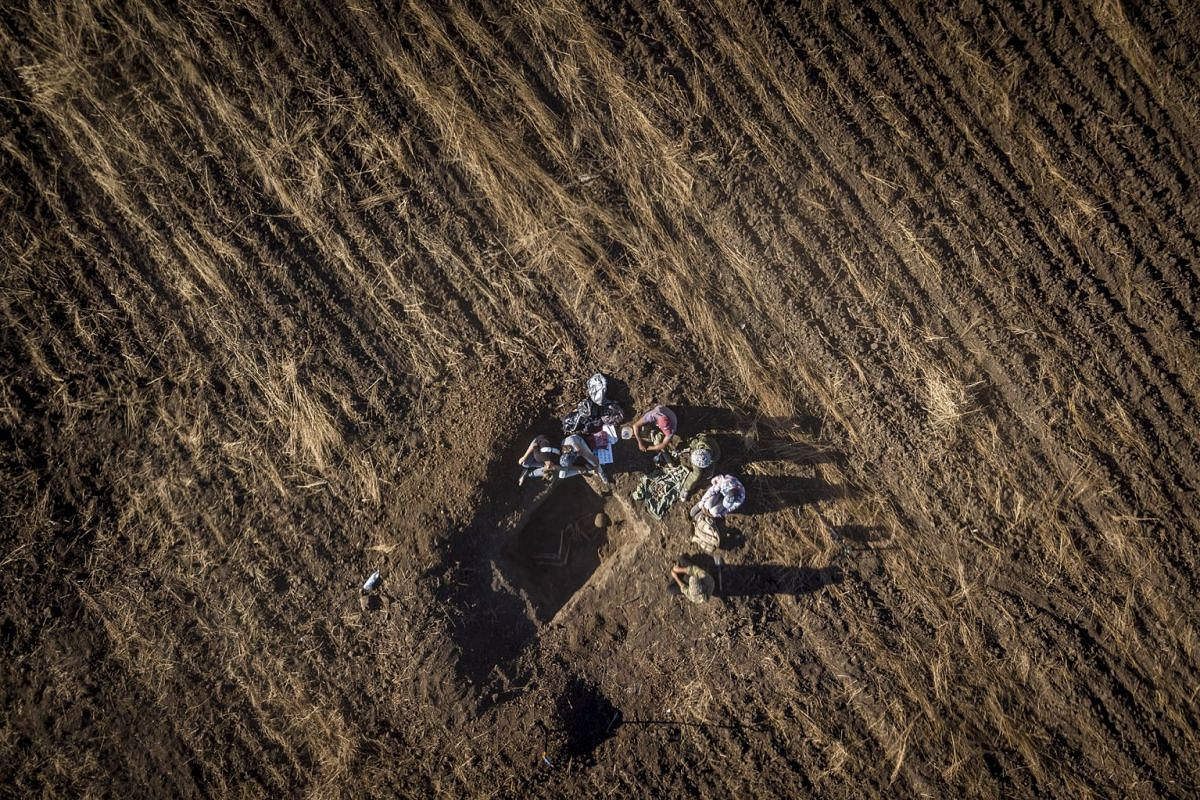 Volunteers unearth a soldier's remains on the outskirts of Volgograd, Russia, where reminders of the Battle of Stalingrad are everywhere, Aug. 14, 2017. Though the city was completely rebuilt after the war and then renamed in 1961, bodies are still