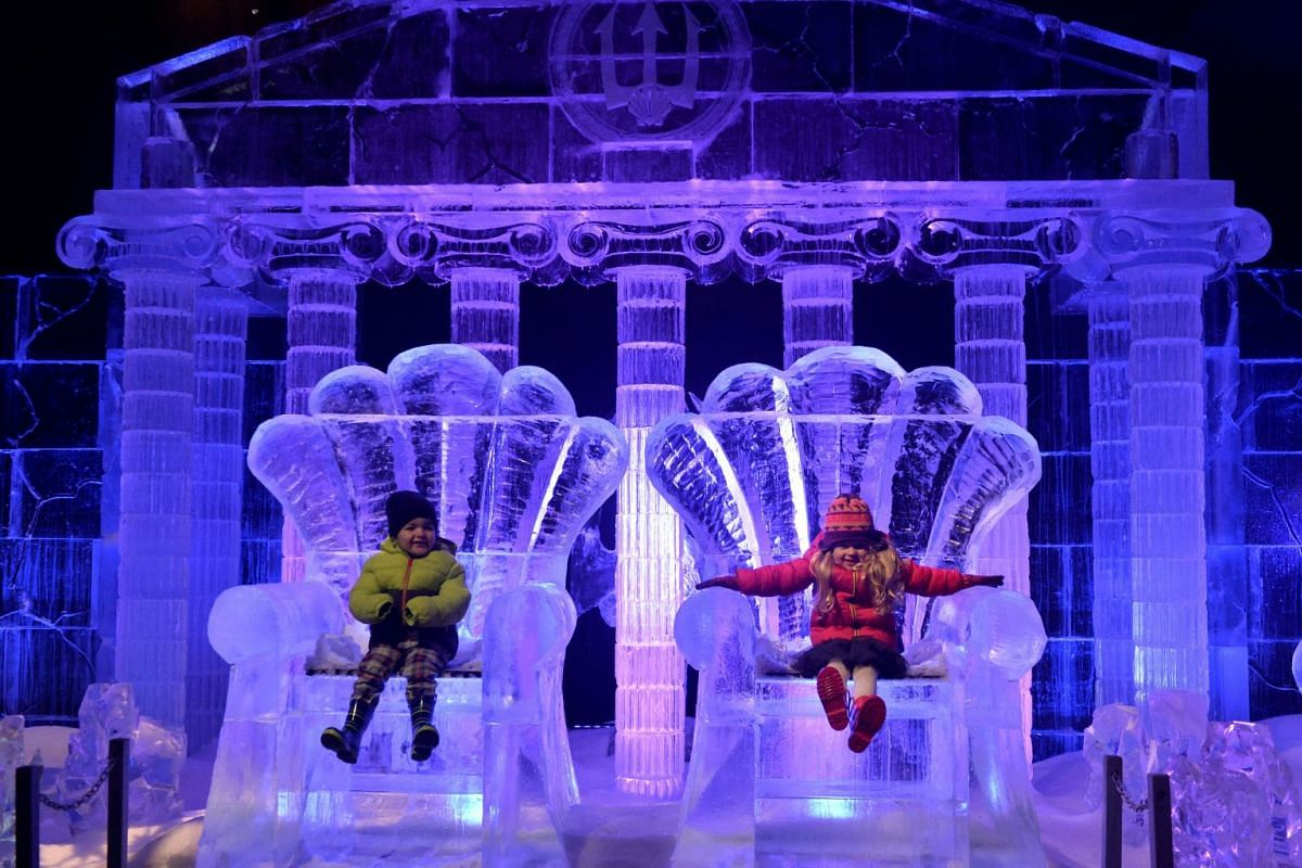Jack Drury, age 3, and Ruby Darragh, age 3, pose with ice sculptures at the launch of Hyde Park Winter Wonderland's Magical Ice Kingdom in London, Britain, November 16, 2017.