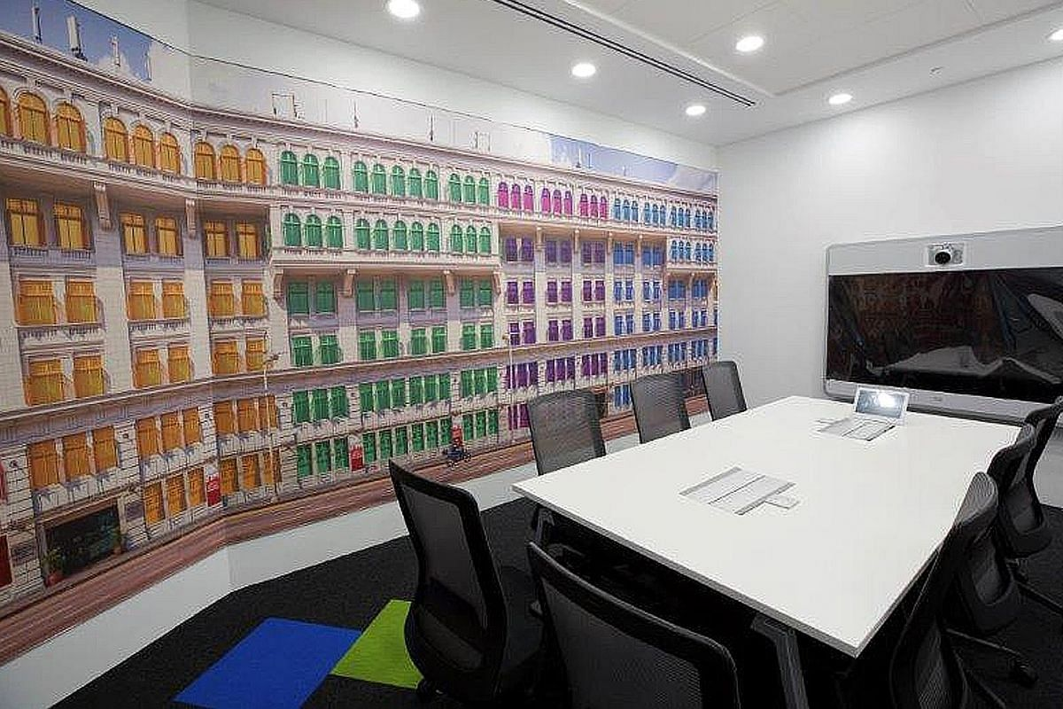 The iconic Old Hill Street Police Station building (above), a Singapore landmark, is depicted in a meeting room. Seating areas in Agoda's Singapore office get a splash of colour with red, yellow, green, purple and blue accents - the hues in the compa