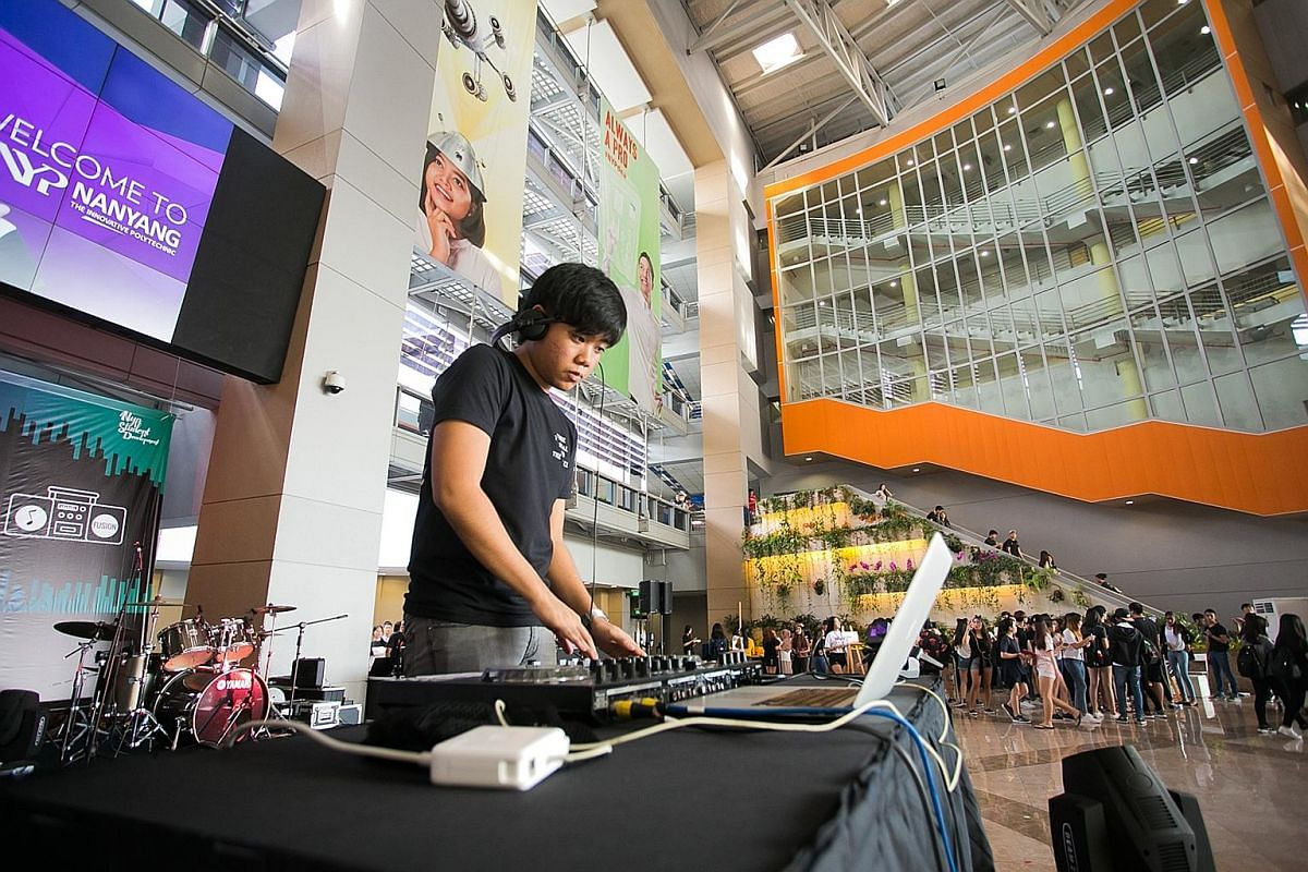 A member of the Live Audio CCA (above) at Nanyang Polytechnic taking the decks. Members of SMU Barworks, a CCA group at the Singapore Management University, are cocktail-making and bartending enthusiasts.