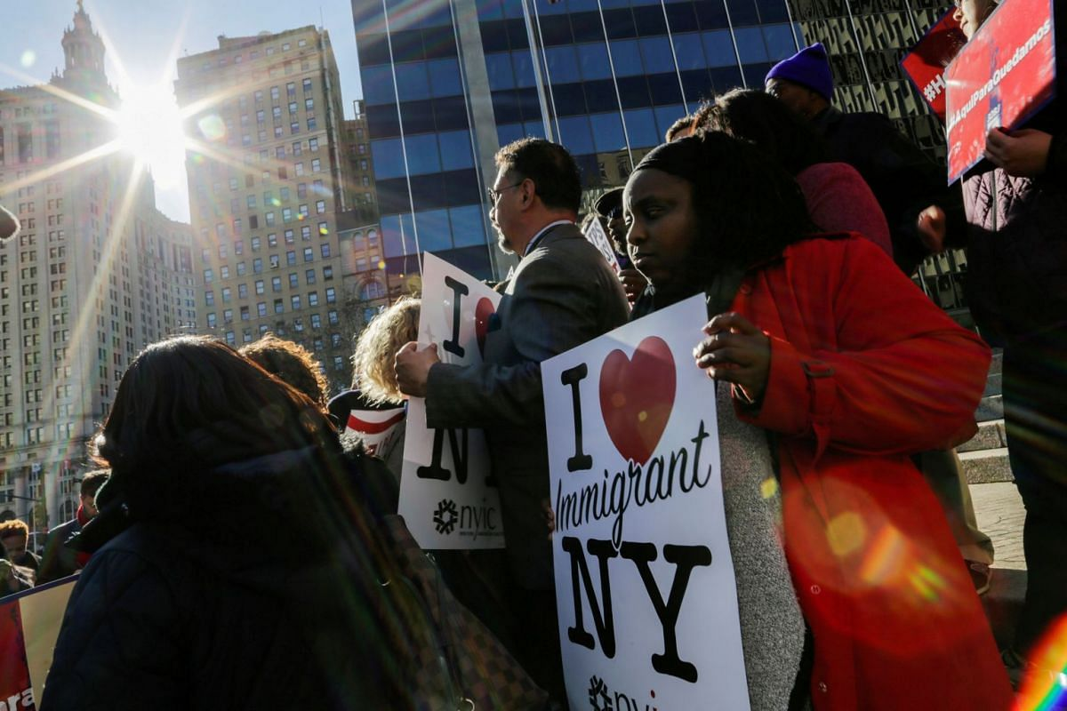 Haitian immigrants and supporters rally to reject DHS Decision to terminate TPS for Haitians, at the Manhattan borough in New York, US on Nov 21, 2017. PHOTO: REUTERS