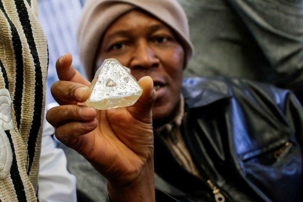 Dennis Kabatto from Seirra Leone holds the 709-carat diamond as it is presented during a news conference before an auction in New York, US on Nov 21, 2017. PHOTO: REUTERS