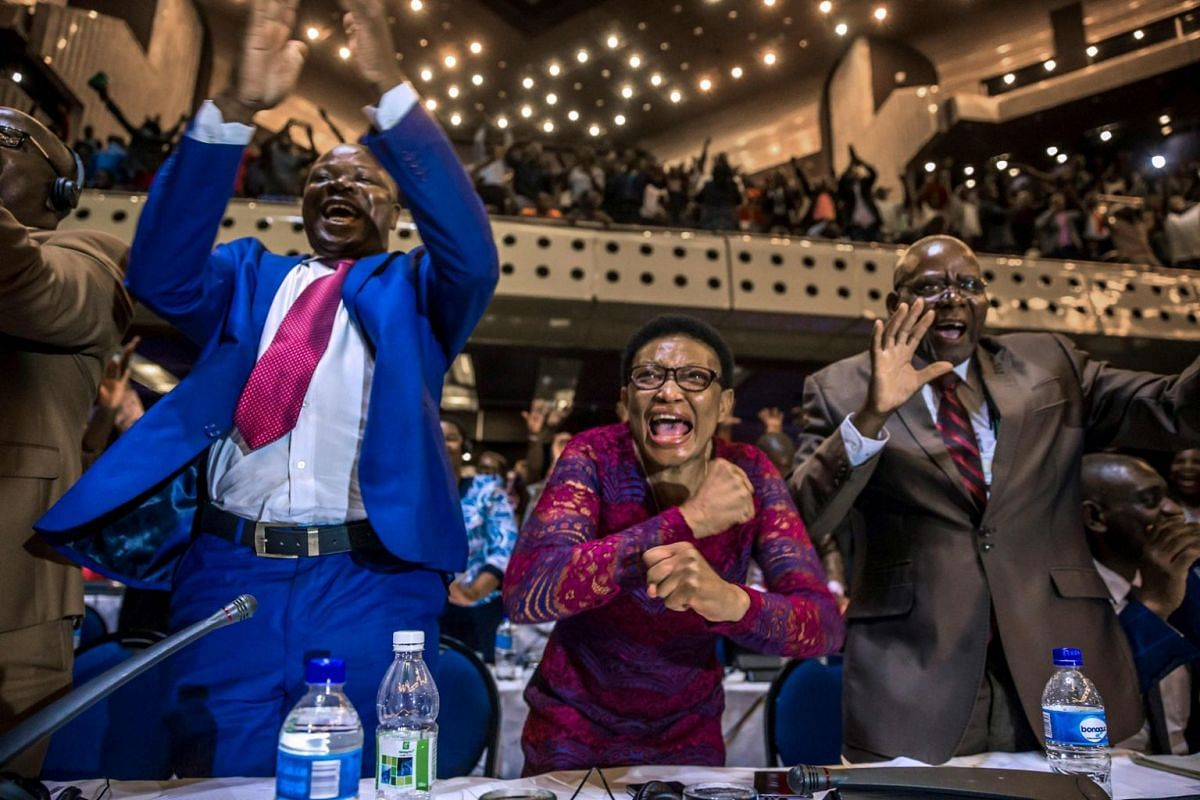 Zimbabwe's members of parliament celebrate after Mugabe's resignation in Harare on Nov 21, 2017.