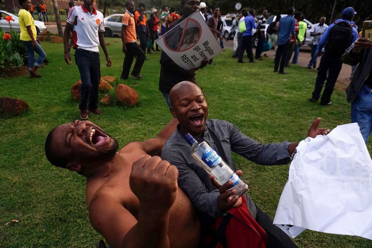 People celebrate in the streets of Harare, after the resignation of Zimbabwe's president Robert Mugabe on Nov 21, 2017.
