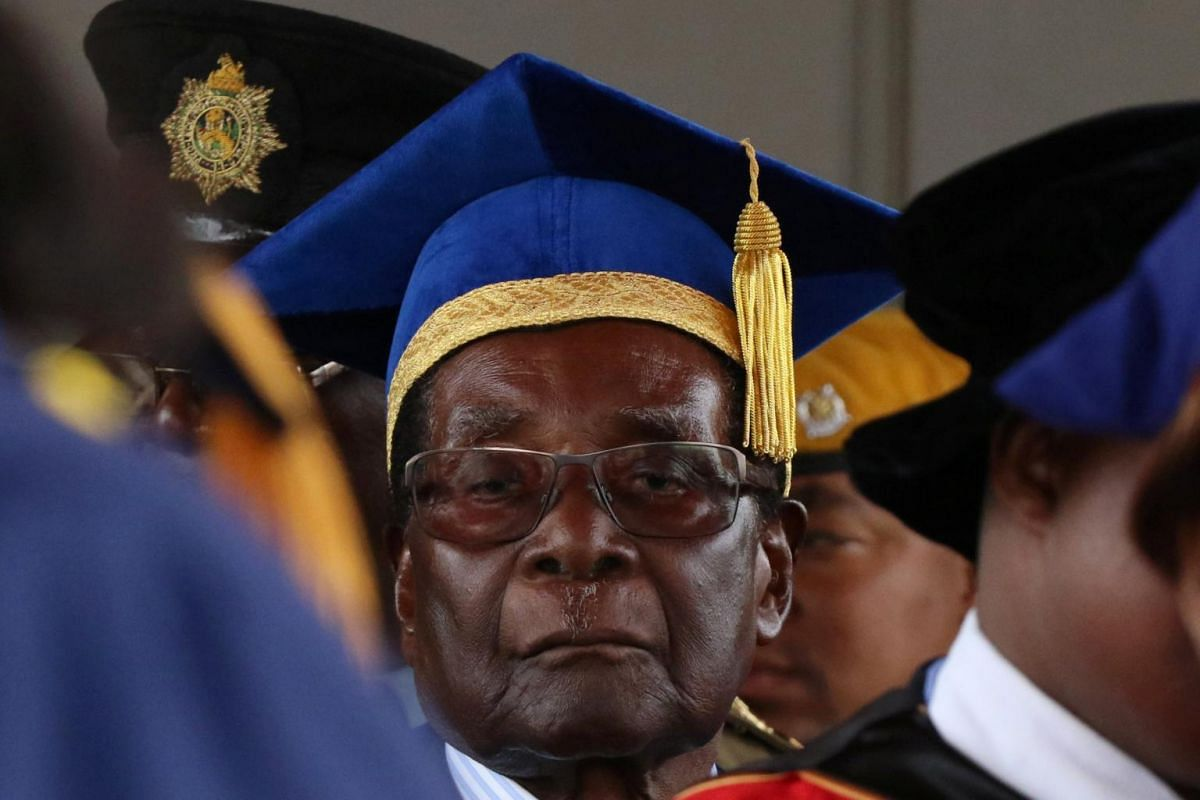 Former Zimbabwe President Robert Mugabe attends a university graduation ceremony in Harare, Zimbabwe, on Nov 17, 2017.
