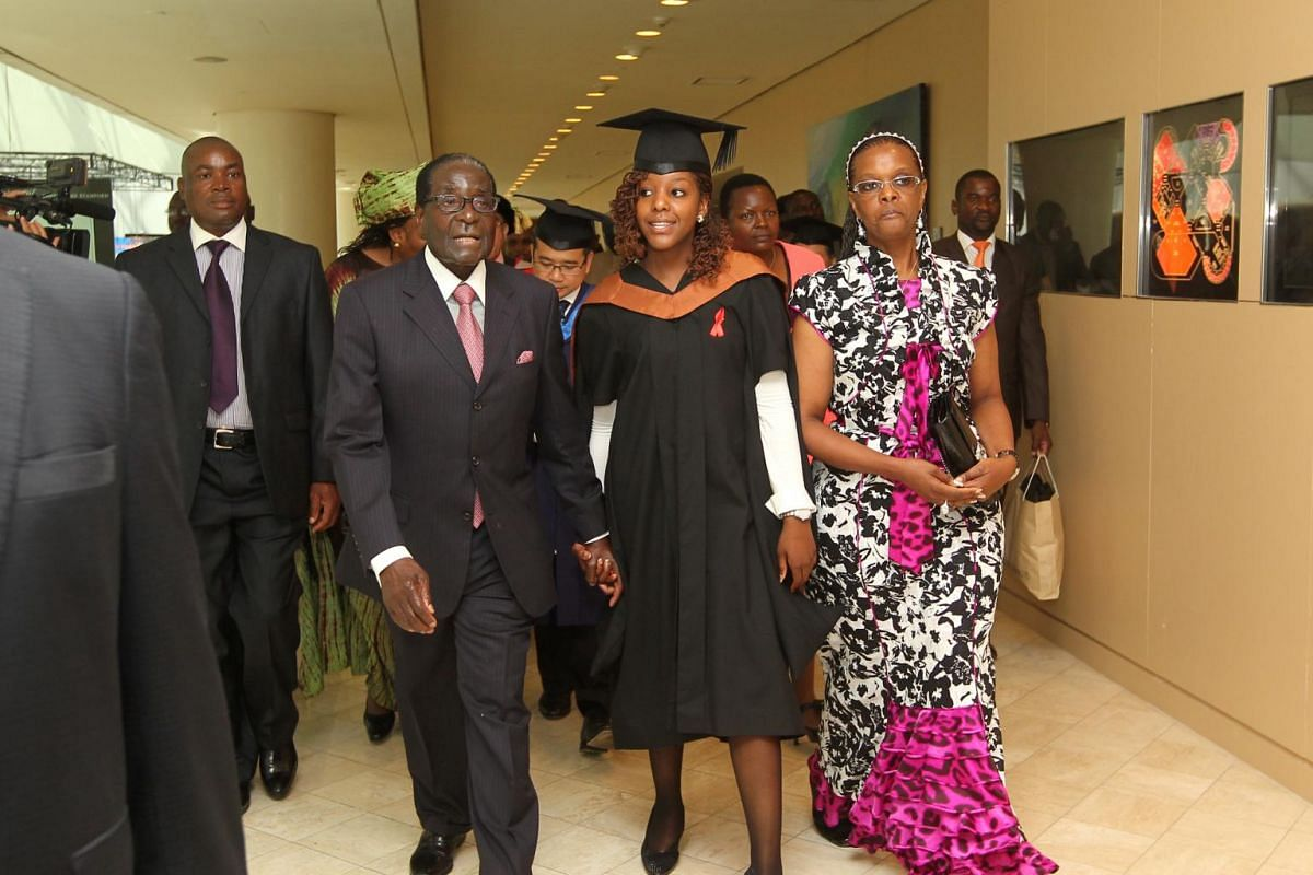 Former Zimbabwe President Robert Mugabe (third, right) left Raffles City Convention Centre a proud father, after attending the graduation of his only daughter, Bona (centre), with his wife Grace (right).