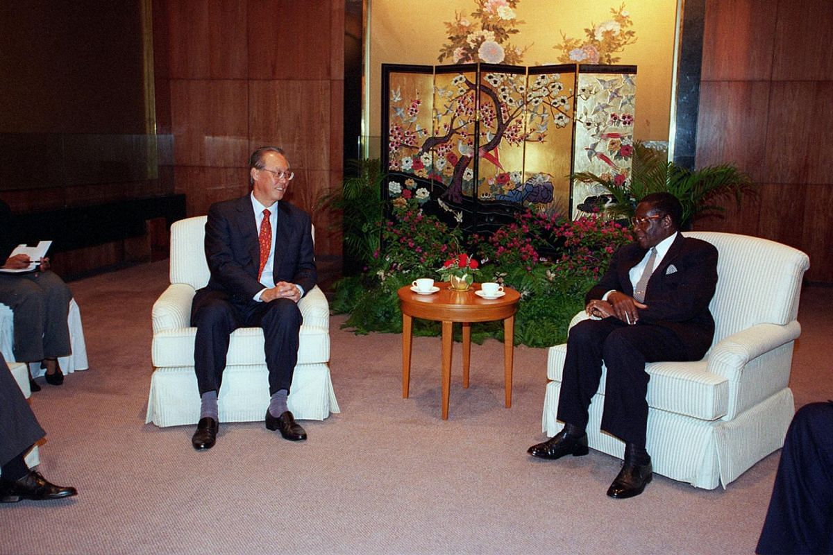 Prime Minister Goh Chok Tong (left) meeting former Zimbabwe president Robert Mugabe during a courtesy call at the Mandarin Hotel.