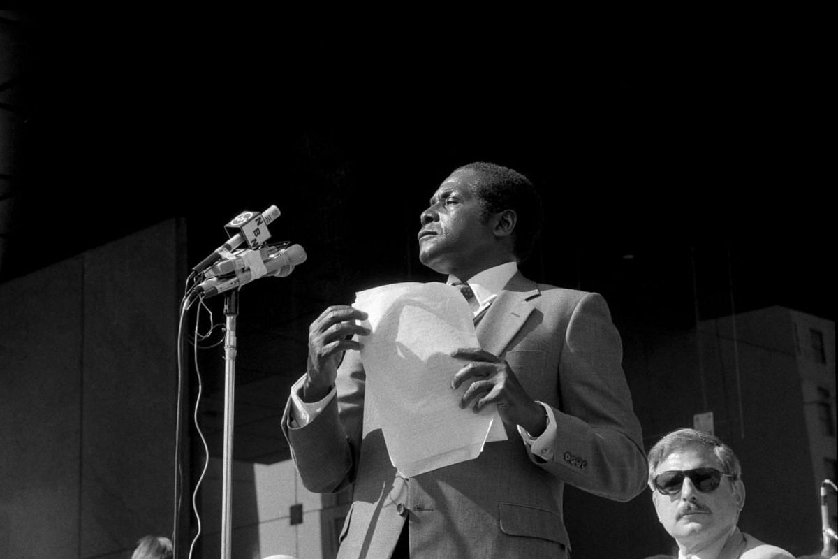 Former Zimbabwe's President Robert Mugabe (left) speaks in New York, on Aug 24, 1980.