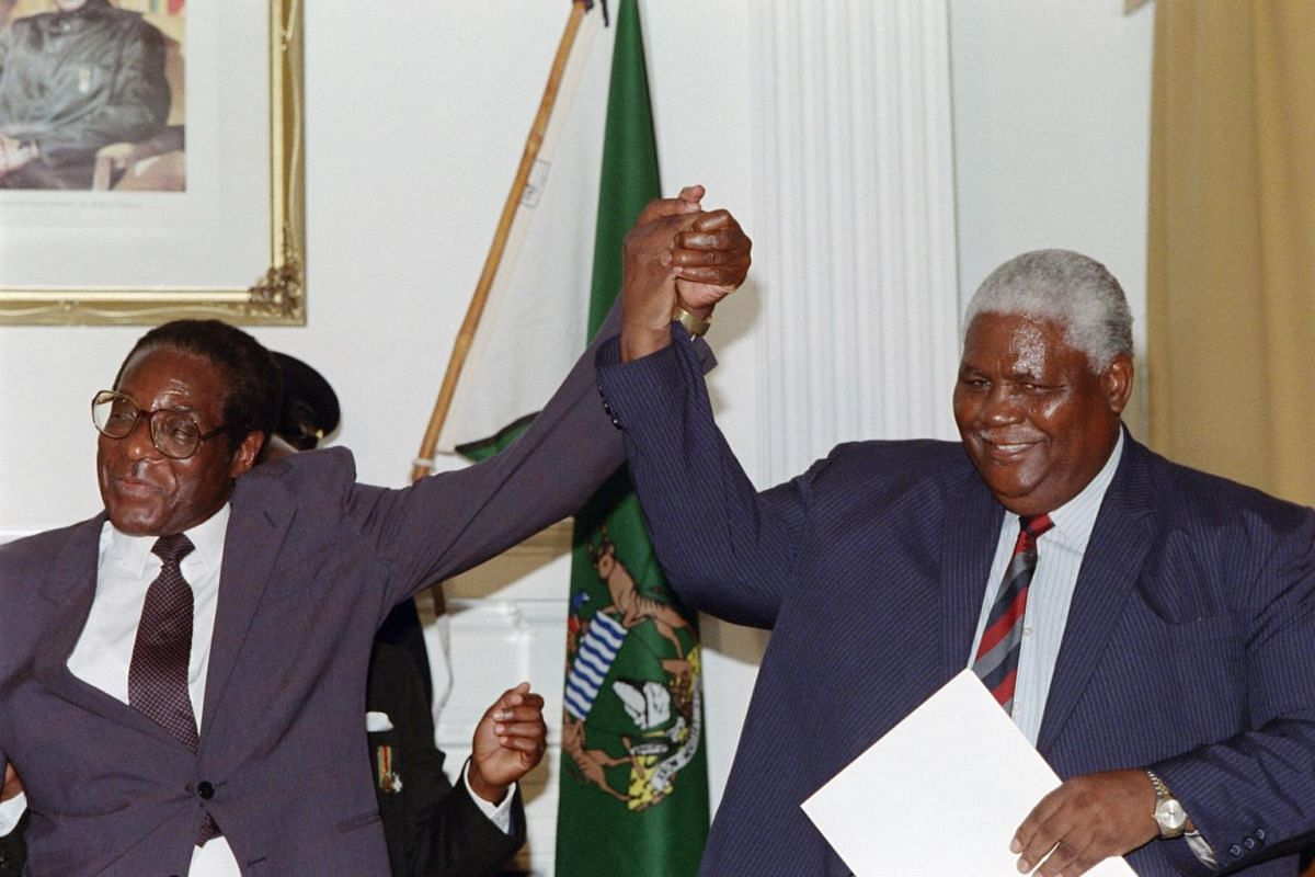 A file photo taken on Dec 22, 1987 shows former Zimbabwe President Robert Mugabe (left) and former President of Zimbabwe African People's Union (ZAPU) Joshua Nkomo raising their fists in Nairobi.