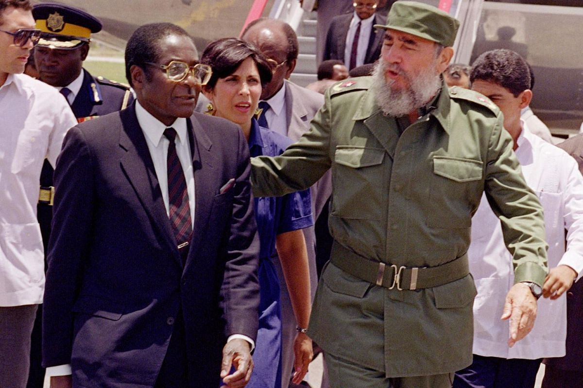 A file photo taken on June 8, 1992 shows former Zimbabwe President Robert Mugabe (left) being greeted in Havana by Cuban President Fidel Castro.