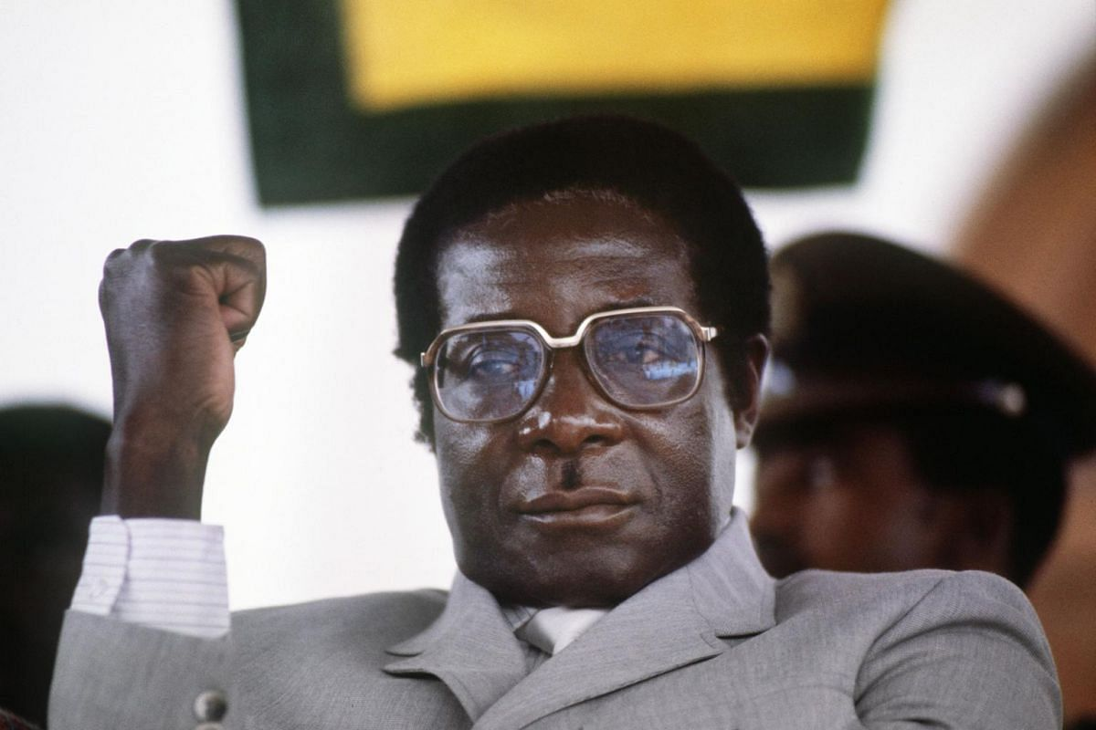 A file photo taken on July 1, 1984 shows former Zimbabwe Prime Minister Robert Mugabe clenching his fist in Harare stadium during a meeting.