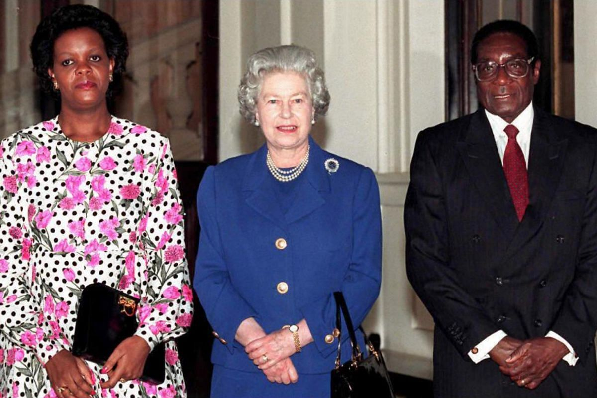 A file photo taken on Feb 3, 1997 shows Britain's Queen Elizabeth II with former Zimbabwe President Robert Mugabe and his wife Grace, posing for photographers after being the Queen's guest at Buckingham Palace.