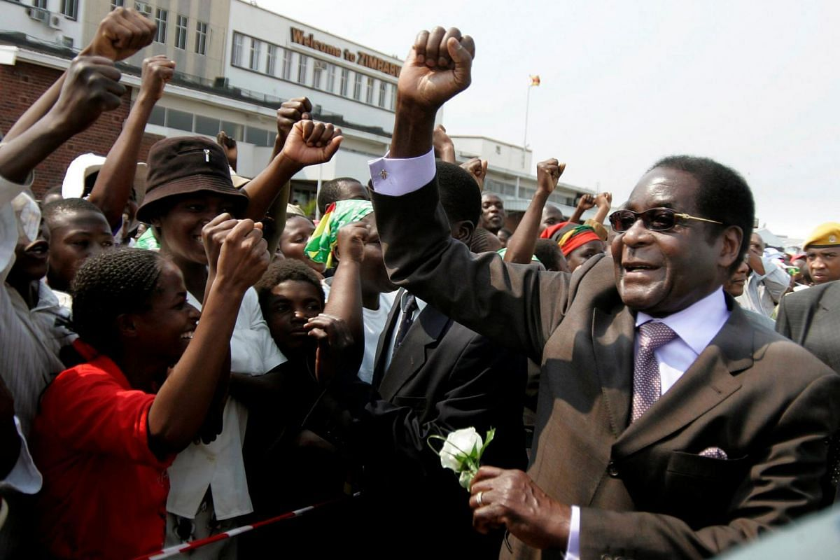 Former Zimbabwe President Robert Mugabe arrives at Harare airport, after attending the UN general assembly in New York, on Sept 29, 2008.