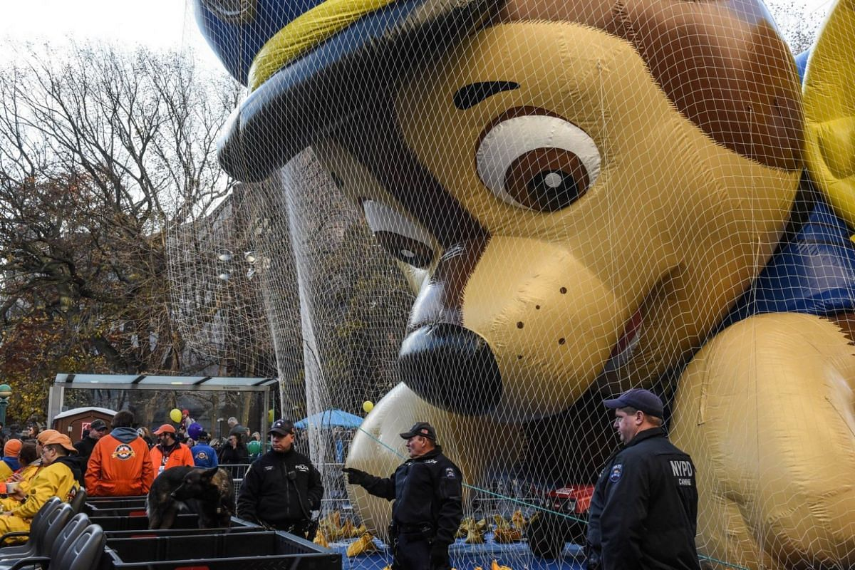 Members of the New York City police department stand guard while balloons were inflated near Central Park ahead of the Macy's Thanksgiving Day parade in New York City on Nov 22, 2017.