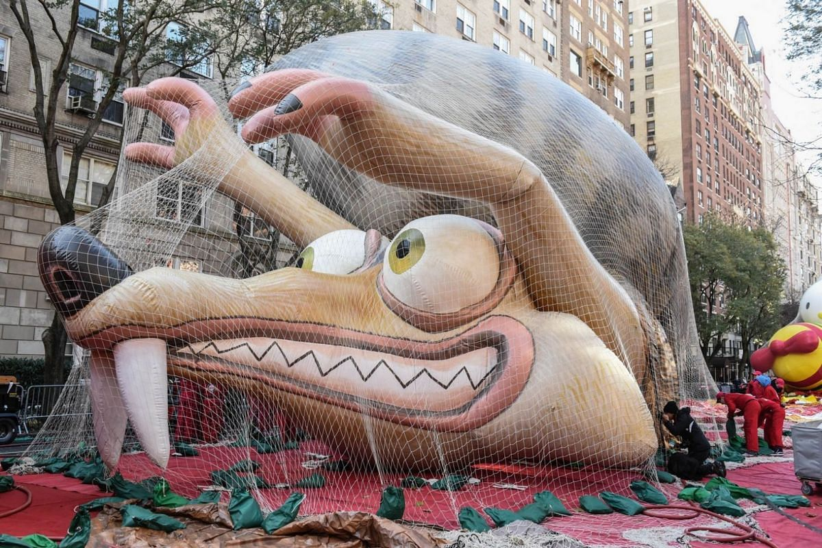 The squirrel from the movie Ice Age sits under protective netting ahead of the Macy's Thanksgiving Day parade in New York City on Nov 22, 2017.