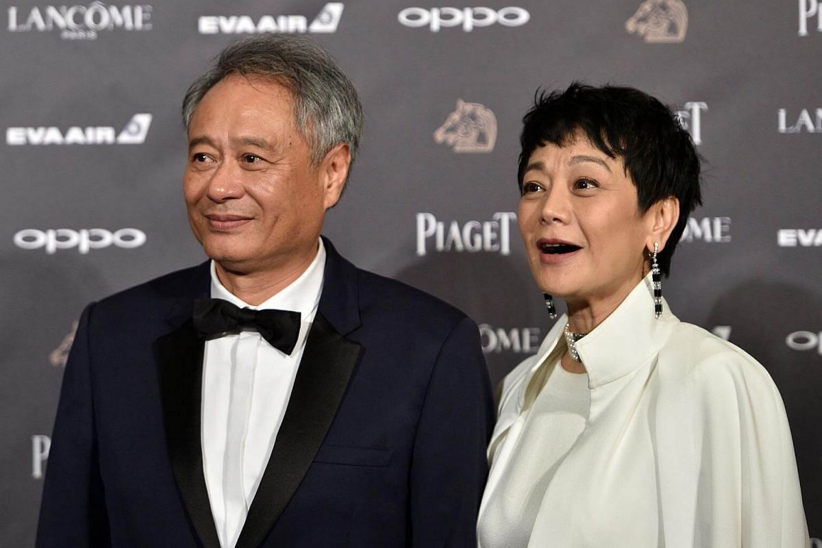 Taiwanese director Ang Lee and Taiwanese director and actress Sylvia Chang posing together on the red carpet at the 54th Golden Horse Awards in Taipei, on Nov 25, 2017.