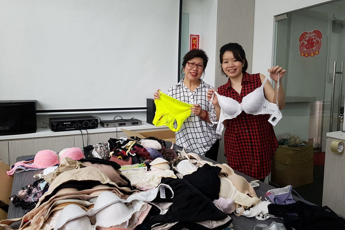 D'Elegance founder and managing director Elida Teh (left) and shapewear consultant Angie Low with some of the thousands of bras donated.