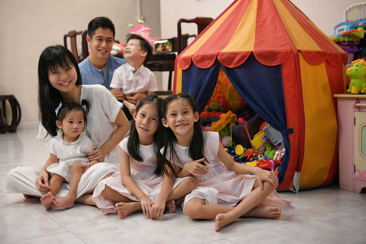 Twins Kayla (left) and Keira Chia, with their parents Nicholas Chia and Ashley Hong, younger brother Keyan and youngest sister Kara.