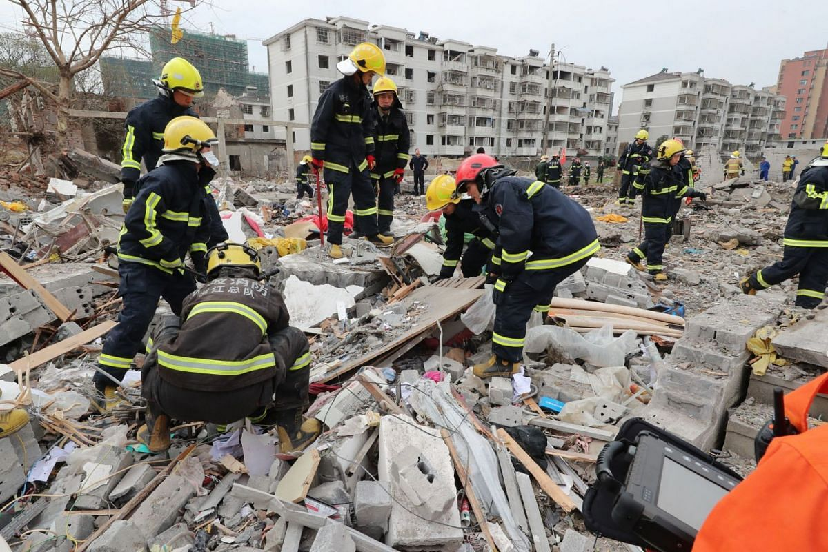 Rescue workers look for survivors after an explosion in Ningbo, China's eastern Zhejiang province on November 26, 2017. A major explosion hit China's eastern port city of Ningbo on November 26, sending dozens to hospitals, destroying vehicles, and tr