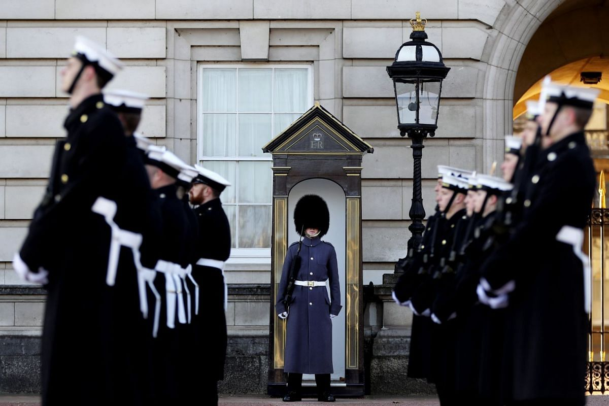 A handout photo made available by the British Ministry of Defence (MOD) showing British Royal Navy Guards preparing to take over the guarding at Buckingham Palace from the Army during a historic Changing of the Guard ceremony at Buckingham Palace, ce