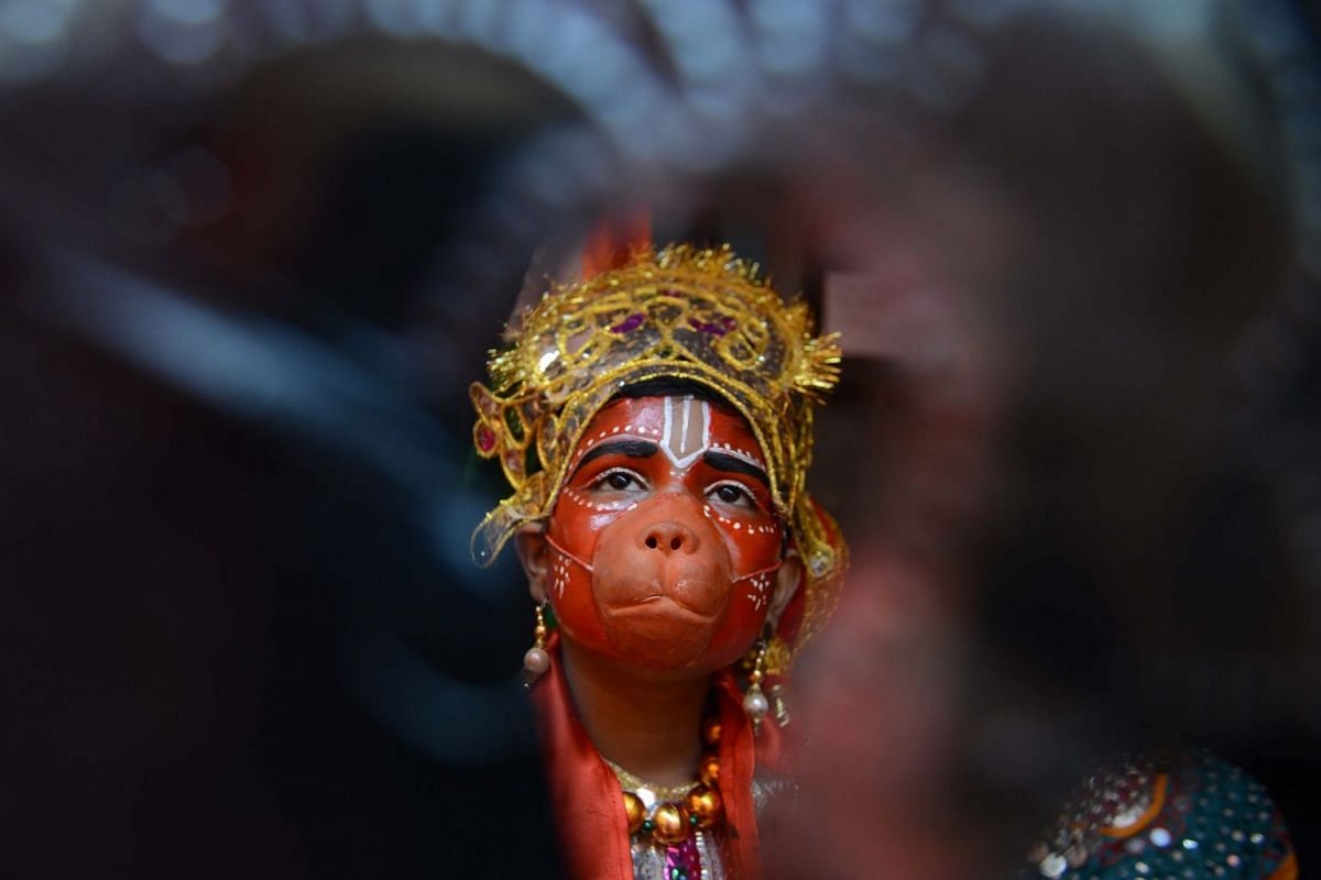 An Indian hild dressed as Hindu god Lord Hanuman waits to perform during a fancy dress competition at a school in Amritsar on November 26, 2017. PHOTO: AFP