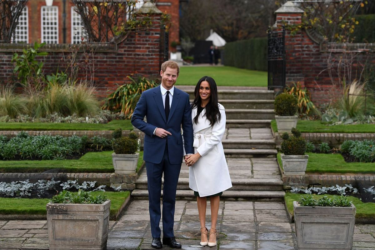 Britain's Prince Harry (L) poses with his fiancee, US actress Meghan Markle during a photocall after announcing their engagement in the Sunken Garden in Kensington Palace in London, Britain, November 27, 2017. Clarence House said in a statement that