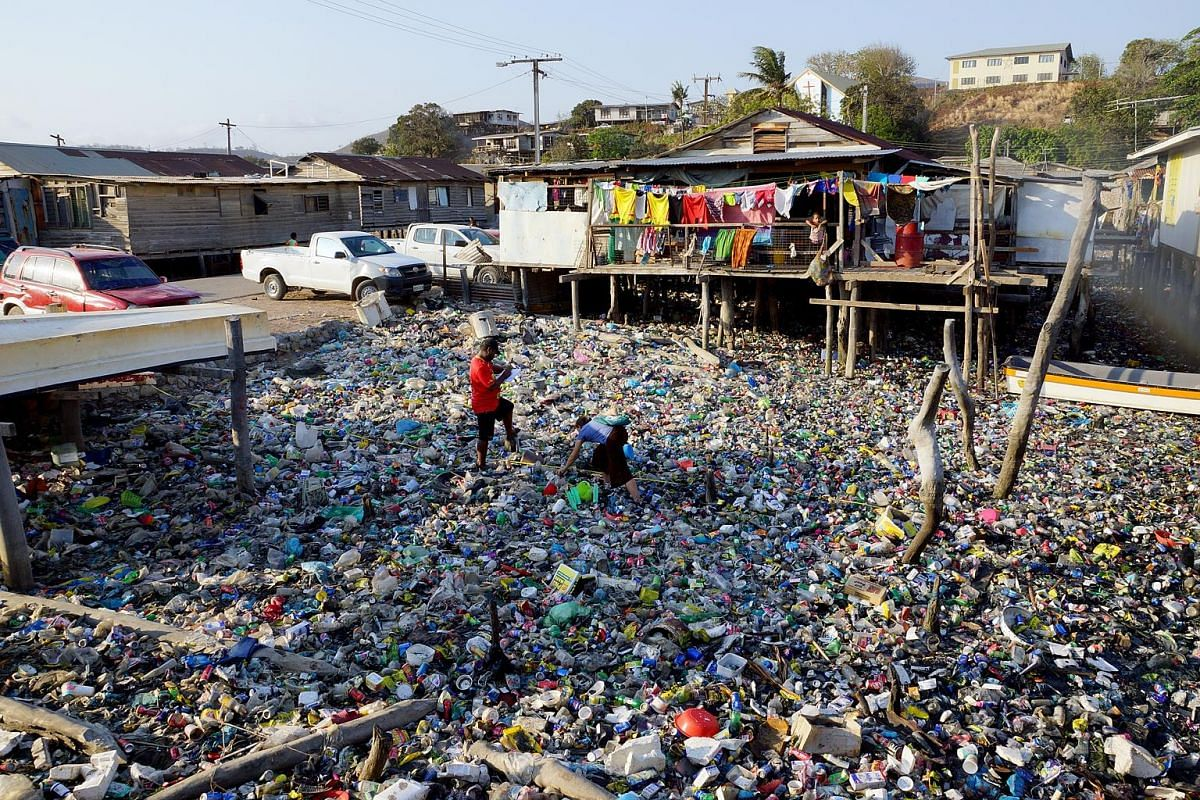 A woman sorts recyclable plastic bottles outside Hanoi. Between 60 per cent and 70 per cent of marine plastic waste comes from China, Vietnam, the Philippines, Indonesia and Sri Lanka. Dense plastic waste chokes the shoreline of a village in the Solo