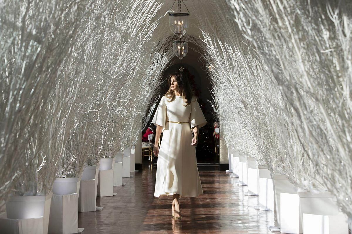 US First Lady Melania Trump walks down the East Colonnade, adorned with Christmas decorations, at the White House on Nov 27, 2017.