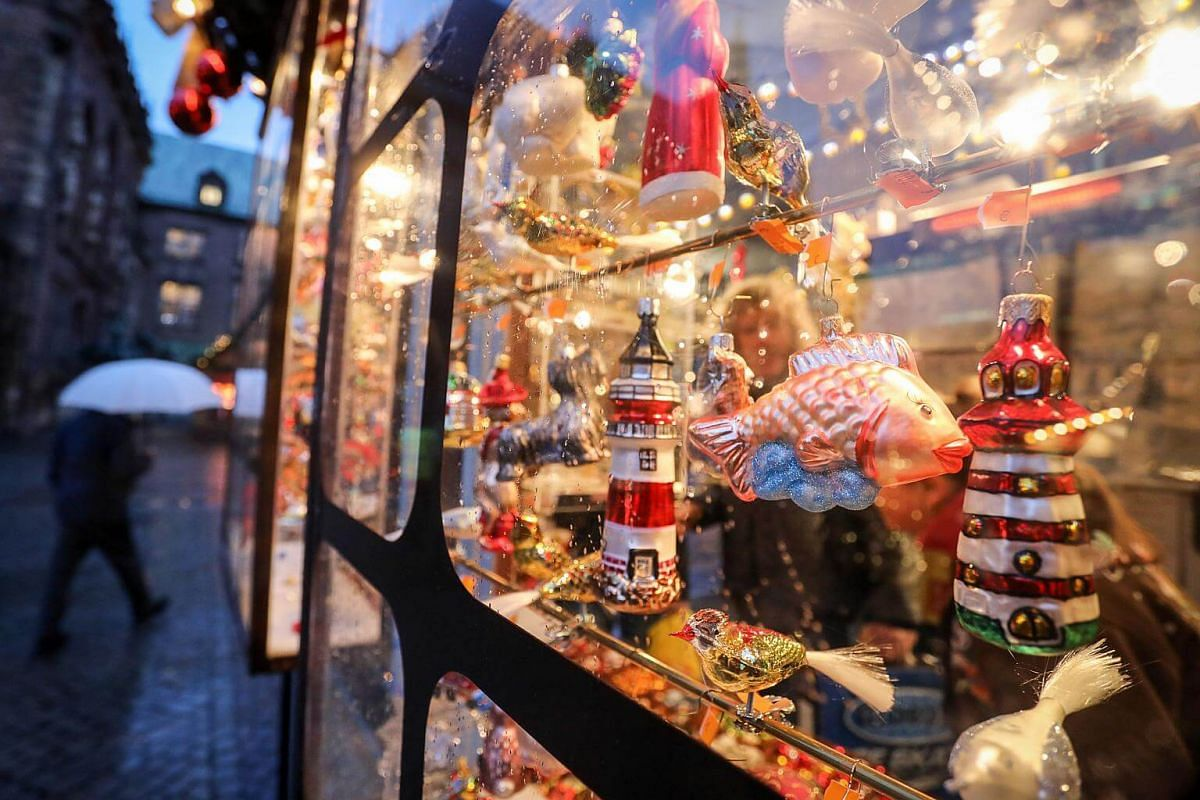 Christmas tree decorations on display in a shop window at the Christmas Market in front of the historic city hall of Bremen, Germany, on Nov 27, 2017.